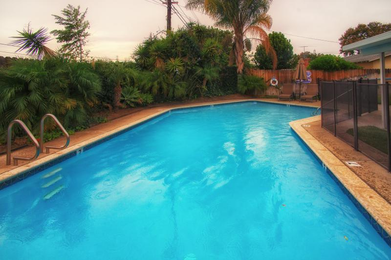 Private Heated Swimming Pool with Safety Fence - King's Vacation Rental - Anaheim - rentals