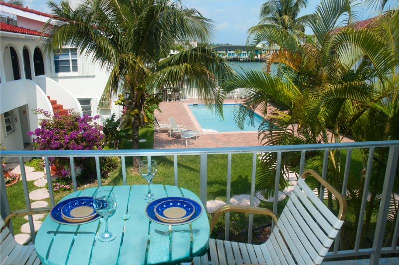 The balcony has an amazing view over the pool and the water beyond. - Lovely 1-Bed Apartment close to Beach and shops - Freeport - rentals