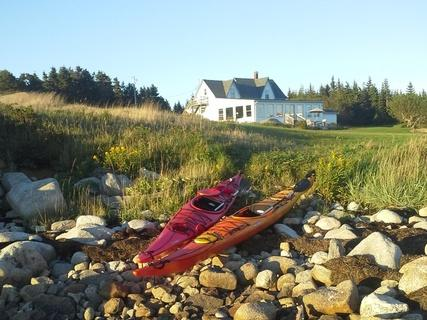 Kayaks waiting along the shore - Ocean's Playgound Cottage, Barrington, Nova Scotia - Barrington - rentals