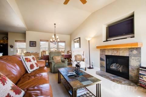 Family room has large flatscreen HDTV, gas fireplace and oversized windows. - Stillwater at Jordanelle - Heber City - rentals