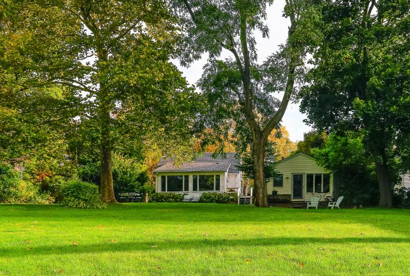The two bedroom house and detached studio are located on a park like acre - 2 Bedroom House With Detached Studio, Water Views - Southold - rentals