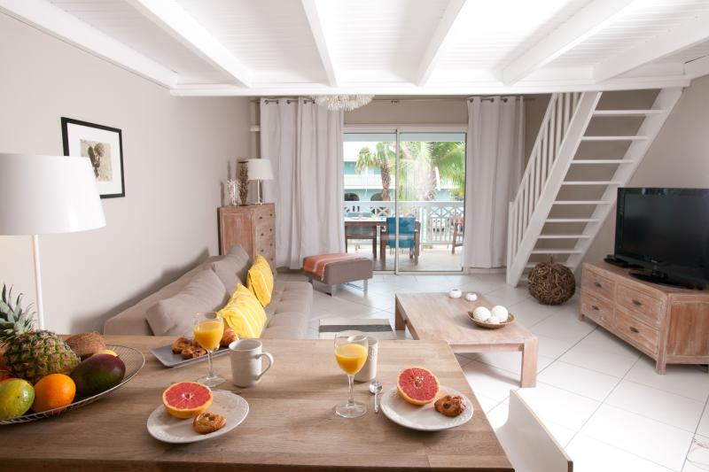 STAY 7 NIGHTS SAVE 1 NIGHT FREE- BEACHFRONT CONDO - Image 1 - Orient Bay - rentals