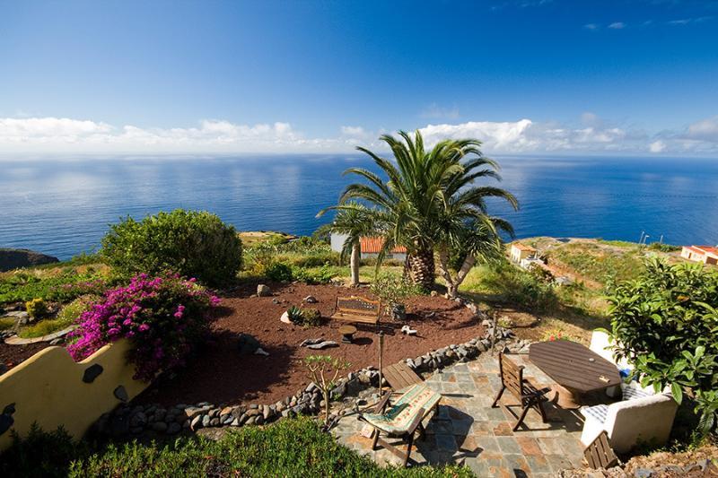 View from bedroom window of Casita patios, gardens and sea - La Casita, romantic cottage with stunning sea view - Garafia - rentals