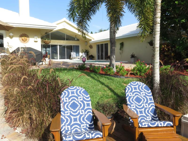 Tropical backyard with private pool, patio, dock and deck on the water. - Luxury Waterfront Home, pool & 1 mile to beach - Deerfield Beach - rentals