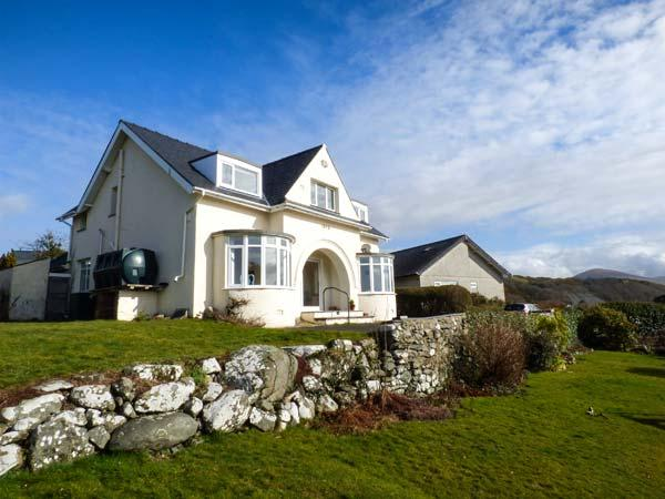 BRYN HOEL, detached, double bay fronted cottage, sea views, roll-top bath, off road parking, in Llanfair, Ref 905040 - Image 1 - Llanfair - rentals