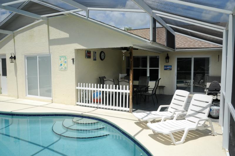 Covered area poolside - Andy's Florida Villa, Pet-Friendly Vacation Rental - Kissimmee - rentals