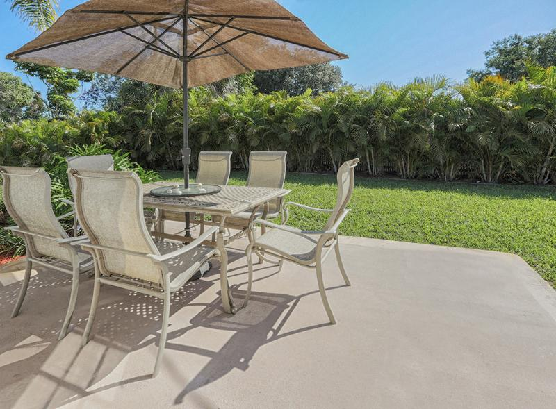 Enjoy meals outside at the shaded patio table which seats 6 people - Breezy Villa Tropical Retreat w Private Beach/WiFi - Venice - rentals