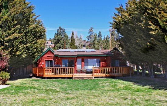 Fawnskin Cove - Back of the cabin. This section faces Big Bear Lake - Fawnskin Cove Lakefront Cabin you will enjoy this cozy and quiet lakefront Vacation Cabin in Big Bear that has an outdoor hot tub, wifi and is dog friendly. - Big Bear Lake - rentals