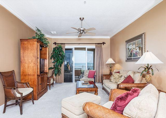 Bask in the sunlight in our tropically elegant living room - Cinnamon Beach 634 Resort, 3rd Floor Ocean Front, 5 Star Condo, Wifi - Palm Coast - rentals