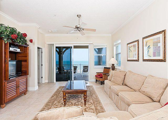 Pile on our plush 16' sectional for movie night on our HDTV! - Cinnamon Beach 845, 4th Floor Ocean Front, Corner Condo, HDTV, Sweeping Views - Palm Coast - rentals