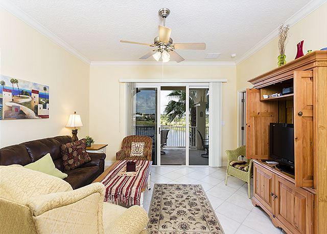 The lovely lake views follow you inside from the balcony! - Cinnamon Beach 1033, new HDTV, Tile, Newly Painted, 2 pools, beach, wifi - Palm Coast - rentals