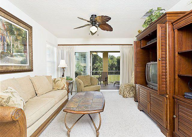 Our living room features modern furniture - Canopy Walk 1121, Gated, End Unit, 3 bedrooms,wifi, pool, spa, fitness room - Palm Coast - rentals