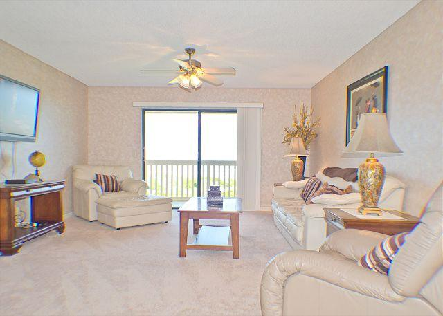 Our beatutiful living room has ocean views and an HDTV - Sea Haven 522 Beach Front, Pool, St. Augustine Beach - Saint Augustine - rentals