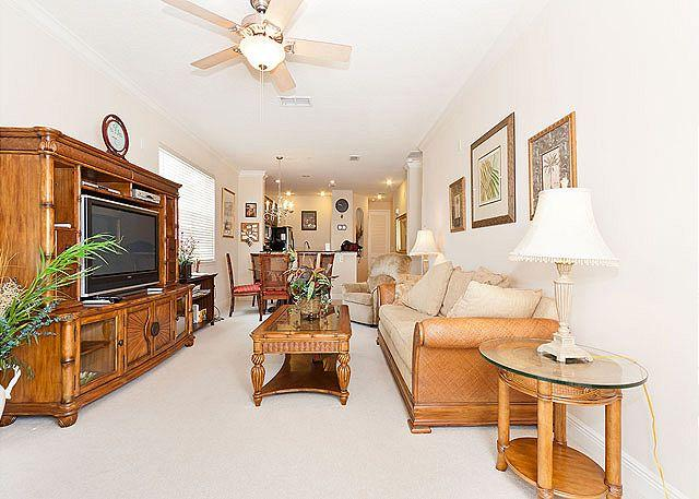 Living area with big screen HDTV and open dining room - Tidelands 1817, Ground Floor condo, HDTV, Screened Lanai - Palm Coast - rentals
