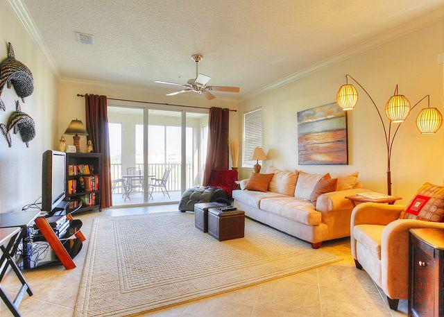 Our newly decorated living area and lanai - Tidelands Sunshine Condo, newly updated, new mattresses, HDTV, movie library - Palm Coast - rentals