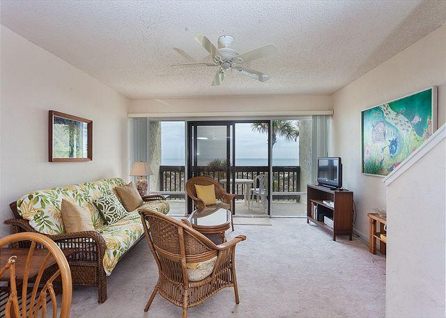 Our bright and sunny living room is the perfect place to relax! - Island House A 207 Beach Front Rental, HDTV, Pool, St Augustine Beach Florida - Saint Augustine - rentals