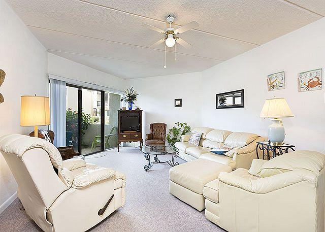 Sink into a comfy chair after a fun day on the surf! - Island House C 108 Ground Floor Flat, Ocean Views, HDTV, Pool, Tennis - Saint Augustine - rentals