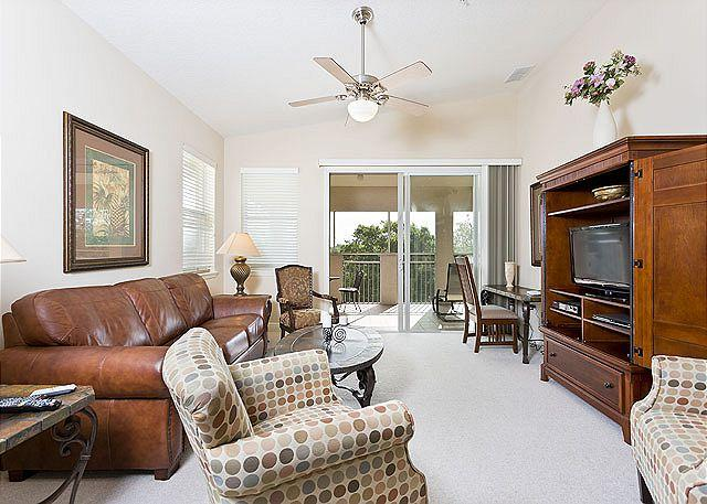 The spacious living room offers glorious tropical views - Tidelands 1942, 2 pools, spas, fitness center, wifi - Palm Coast - rentals