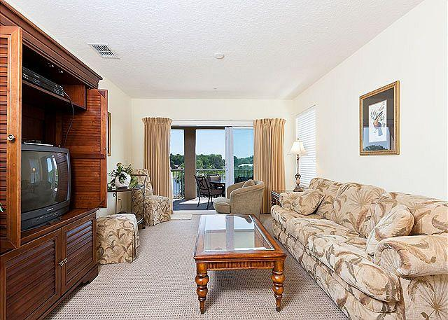 The living room is a beautiful spacious gathering spot. - Canopy Walk 635, 3 bedrooms, 2 baths, 3rd Floor, Intracoastal View, new HDTV - Palm Coast - rentals
