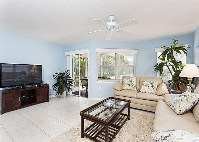 Enjoy the huge HDTV and leather sofas in the living room - Gulf & Bay Club: Bayside, 2 Bedrooms, Ground Floor, 2 pools, gym, tennis - Siesta Key - rentals