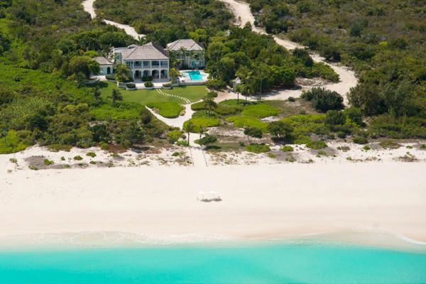 This extraordinary 18- acre estate offers more than 600 feet of private beachfront on Grace Bay. PL AMZ - Image 1 - Leeward - rentals