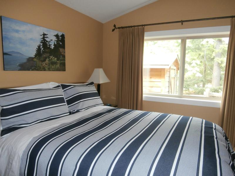 Sleep in late, or enjoy an afternoon nap in your own bedroom with blackout drapes, queen bed and TV - Dana's Cozy Cottage, a Parksville Holiday Home - Parksville - rentals