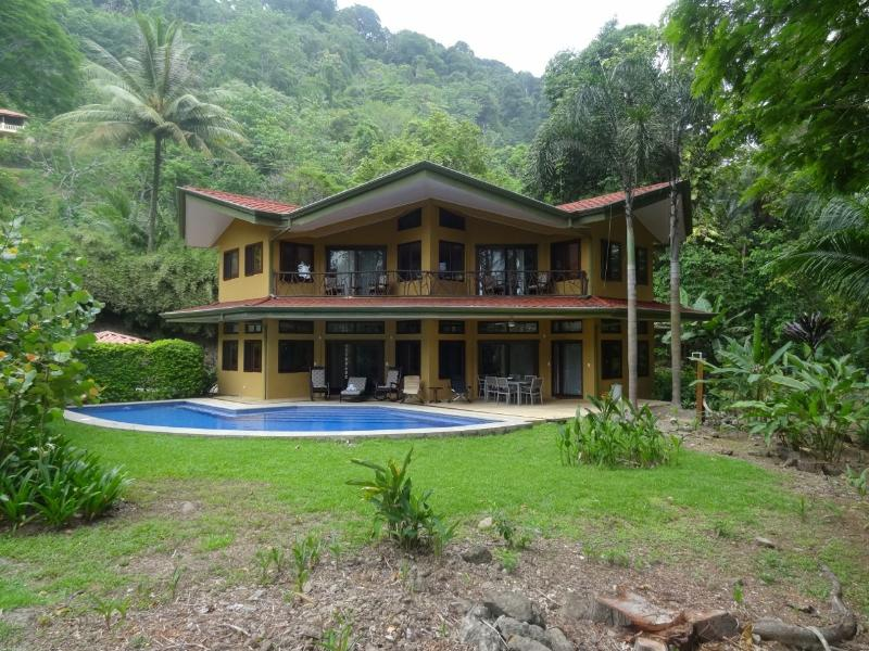 Outside of the home on a cloudy day. Two stories, with lots of overhangs to protect from sun/rain. - Beachfront Home with Gorgeous Pool near Dominical - Dominical - rentals