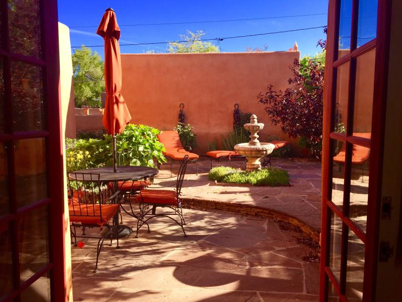 Kitchen open to Beautiful Courtyard: Outdoor Dining, Chaises, Infrared BBQ, Fountain - Luxury Adobe, Walk Everywhere, Labor Day $395 nt.! - Santa Fe - rentals