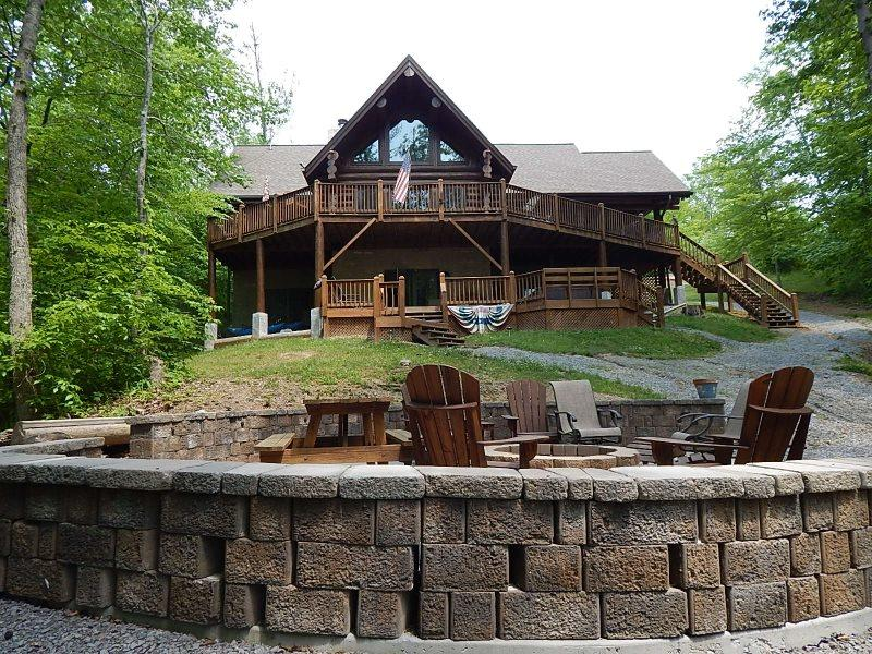 Heaven Sent view from fire pit up to back side of house - Heaven Sent includes a private covered dock and secluded cove with an amazing fire pit. Enjoy! - New Tazewell - rentals
