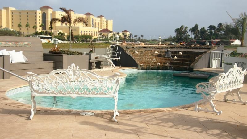 Pool area - $ 99 P/N 2 persons, The Double Rooms Modern World - Palm/Eagle Beach - rentals