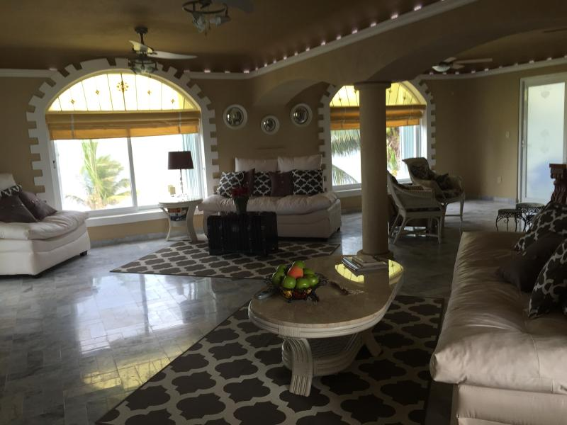 Spacious Living Room with in-direct lighting in living room and dining room overlooking beach - Beach Condo, 3 bd., family oriented. A real WOW! - Puerto Morelos - rentals