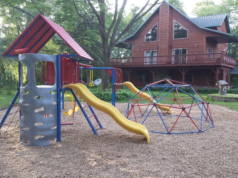Play area and playset - Devil's Lodge - Luxurious Family Vacation Home - Wisconsin Dells - rentals