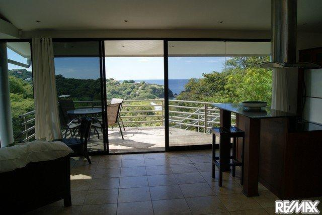 Your morning coffee or afternoon sunset drink on the deck off the living area - Modern 2 BR/2BA Ocean View home in Playa Ocotall - Playa Ocotal - rentals