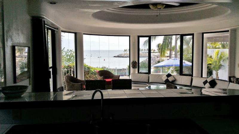 Standing in kitchen overlooking dining, living, private pool and direct beachfront - Beachfront/Marina Side Villa Reasonably Priced - Puerto Vallarta - rentals