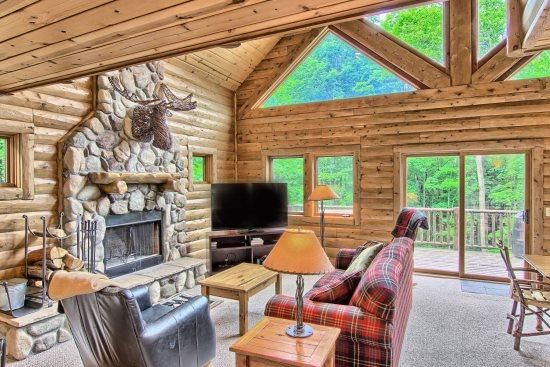 Spacious Livign Room with Queen Sofa Sleeper, 65 in Television, Wood Burning Fireplace, and Amazing Views. - 4BR Mountain Cabin - Skiers Paradise, Slope Side, Sleeps 13, Wood Burning Fireplace - Boyne Falls - rentals