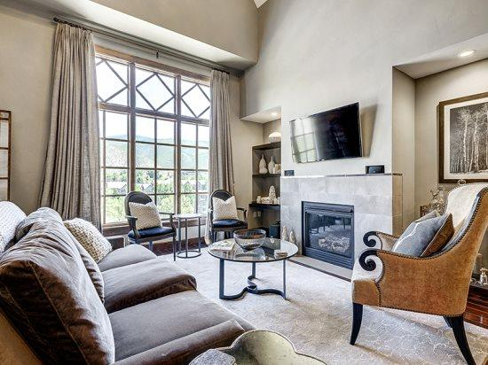 Spacious Living Room with Fireplace, Wall of Windows, Flat Screen TV, and Great Views. - 4BR + Loft Platinum Rated Ascent Penthouse in Avon, CO at the base of Beaver Creek - Avon - rentals