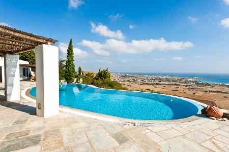 Sea view Agnanti Villa with lush terraced garden, infinity pool & rooftop lounge - Image 1 - Drios - rentals