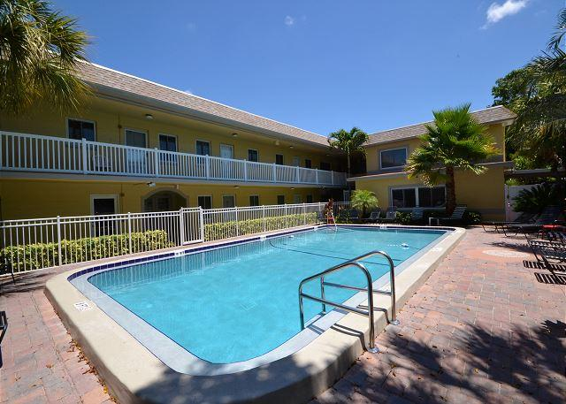 Waves 16 - 2nd floor condo overlooking courtyard pool!  BBQ, Free Wifi & W/D! - Image 1 - Saint Pete Beach - rentals
