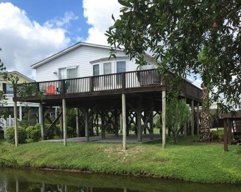 Only a block from the ocean!  The large rear deck overlooks a peaceful canal! - Beach Haven in The Keys at Oceanside Village - Surfside Beach - rentals