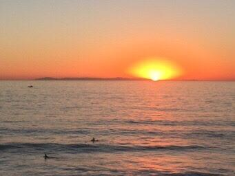 An actual photo from the complex - stunning sunset dropping over Catalina Island - FROM $105 / Ngt - Lux 1 bed Condo - walk to beach - Dana Point - rentals