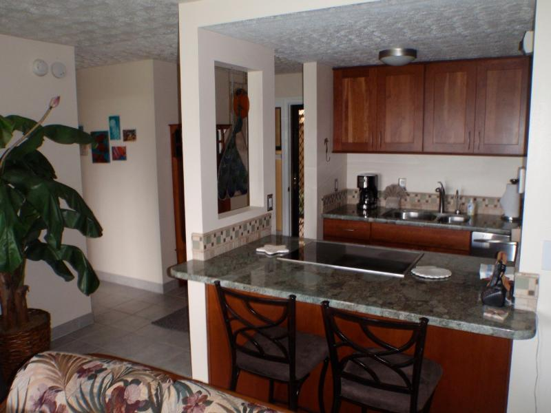 Beautiful kitchen opens to the living room - both have an ocean view - Maui Vacation Rental on the Beach at Ma'alaea - Maalaea - rentals