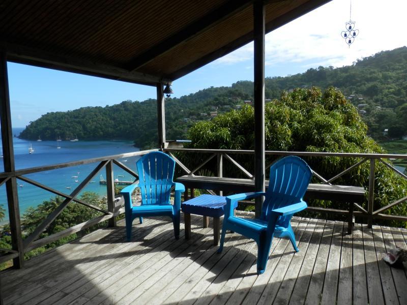 The deck and the blue Caribbean Sea - Bella Vista Cottage, Charlotteville, Tobago - Charlotteville - rentals