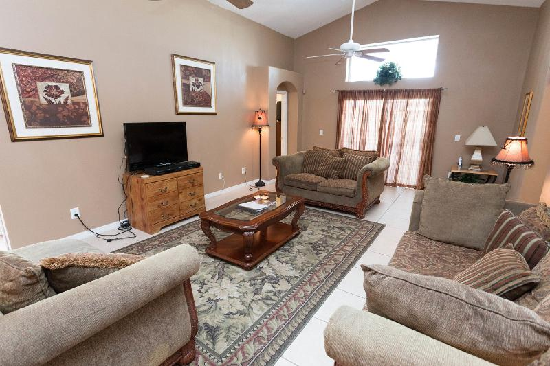 Living Room - Lumiere's Chateau - Spa and Disney Fireworks View - Kissimmee - rentals