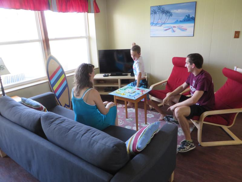 Main room game time - Kids & families love to stay at the Sandy Turtle - Port Aransas - rentals