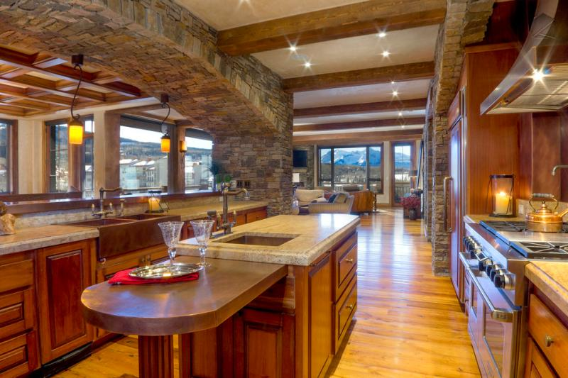 The open kitchen stretches out into the living and dining rooms, making it easy to navigate - These views know no borders. Literally. Close to Gondola - Sunset Peaks at See Forever - Mountain Village - rentals