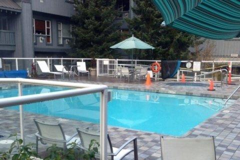 Beautiful Heated outdoor pool and hot tub - Executive 1 Bedroom Condo with courtyard and pool side access, unit #106 - Whistler - rentals