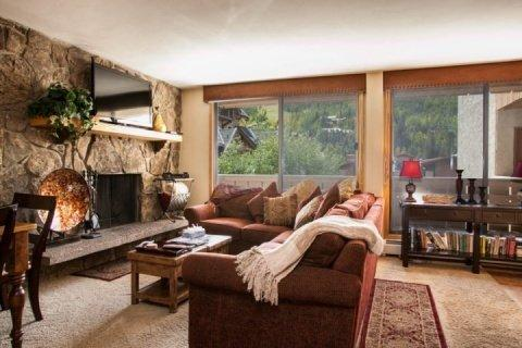 Open living area features wood burning fireplace and mountain slope views. - Cozy Mountain Condo~ Great Walkability~ Heart of Vail & Lionshead! Book Your Mountain Adventure Now! - Vail - rentals