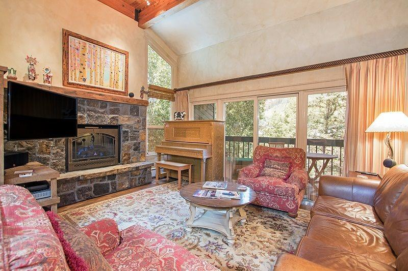 Cozy living area with elegant mountain decor, access to deck - Riverside A 201 - 3 Bd / 3 Ba - Sleeps 8 - Deluxe Condo - Ideal Summer or Winter Location - 2 block walking radius to everything! - Telluride - rentals