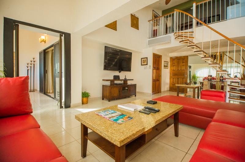 The Great Room with Granite tables - 4 bedroom Sunset Penthouse - steps to the beach - - Cabo San Lucas - rentals