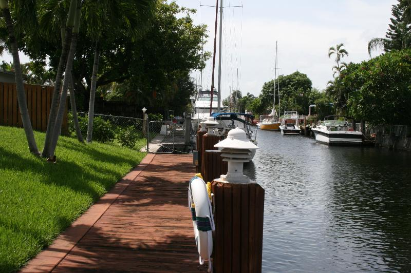 another Beutiful Day looking down the dock down the canal - Fresh & Clean Waterfront with private pool - Fort Lauderdale - rentals